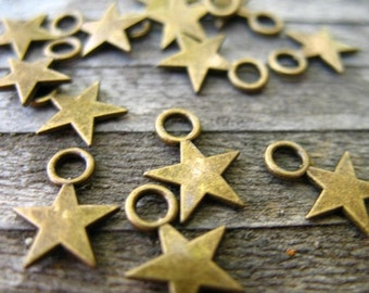 100 Bronze Star Charms 11mm