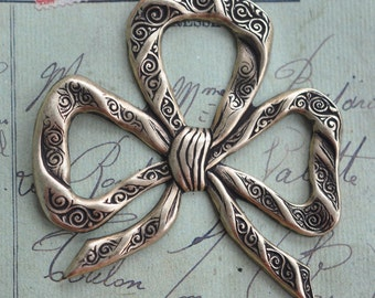 Neo Victorian bow stamping,  brass ox
