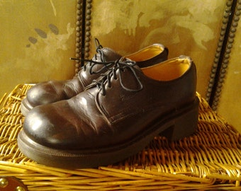 Brown chunky toe Dr Martin shoes.