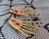 Plastic Skeleton Hand Earrings With Beaded Red Blood Droplets