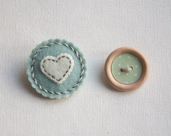 Small round felt brooch in pastel colors