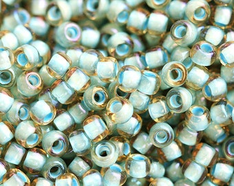 Toho Seed beads, size 11/0, Sea Foam Lined - Inside color Rainbow Lt. Topaz, N 952 - 10g -S101