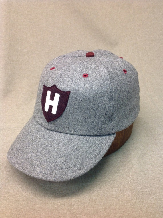 Personalized letter on shield, 6 panel dark grey wool  cap with H shield logo. Fitted with leather sweatband any size.