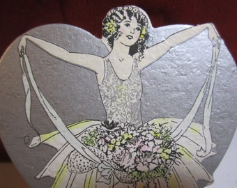 1920's unused art deco die cut silver gilded hand colored Buzza wedding  place card flapper girl in tutu holding ribbons full of flowers
