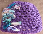 Purple crochet hat for pre-teen or teen girl with textile decoration