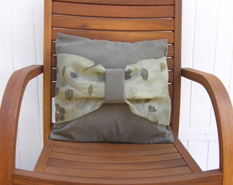 Cushion cover, pillow sham, throw pillow in a green soft mole skin type fabric with bow detail on the front with envelope back.16 x 16 inch