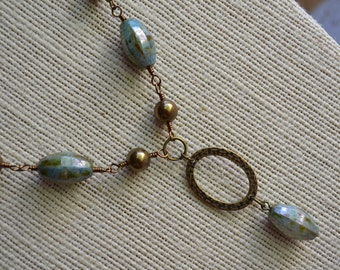Ceramic Ridged Oval Bead and Swarovski Antique Brass Pearl Necklace