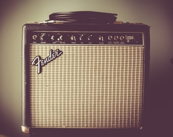 Fender Guitar Amplifier and Guitar Cord Photo