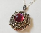 Dragon Breath Fire Opal Silver locket--silver locket