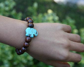 For kids yogi inspired wood bead worry mala meditation bracelet with turquoise colored elephant gemstone