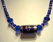 Necklace Dark Blue Crystal with central Glass Gold coloured trail love heart design by JulieDeeleyJewellery on Etsy