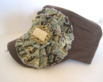 Brown Military Distressed Cadet Army Hat with a Turquoise and Brown Paisley Print Fabric Flower and a Ivory and Gold Stone Accent