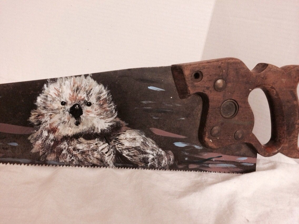 Antique Painted Saw Otter