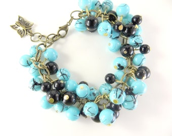 "Turquoise and black cha cha bracelet    (6 1/2 - 7 1/2"")"