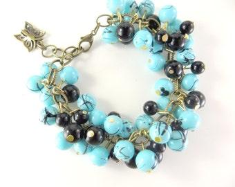 Turquoise and black cha cha bracelet