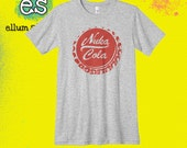 Fallout 3 inspired Nuka Cola bottle cap unisex ringspun jersey t-shirt. Athletic heather tee printed with our red water-based ink.
