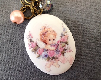 Baby Angel Porcelain Cabochon Necklace. White. Pearls. Pink. Blue. Oval. Angel Necklace. Vintage Style Brass Chain. Aurora Borealis. Cute.