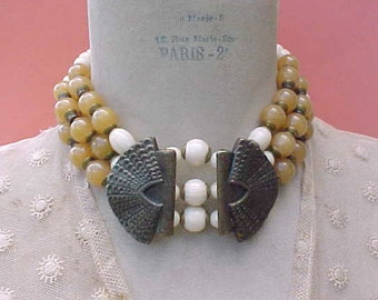 Pretty 1980's Necklace of Ivory and Honey Colored Beads with Large Brass Pieces