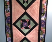 Quilted Table Runner-Pink, Purple Floral Print with Black Border and Pastel Print Reverse