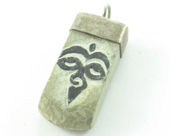 Carved Stone Buddhist Eyes and Om Sanskrit Pendant with Sterling Silver Made in Nepal