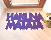 "Fun doormat ""Hakuna Matata"". The Lion King. It means no worries."