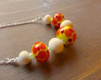 sunny spotty yellow red and orange lampwork bead necklace