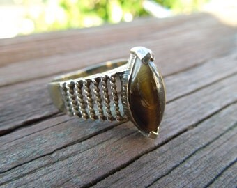 Vintage Silver Ring with Tigers Eye Feature.  Nice condition.  Size 6.  Stamped STERLING