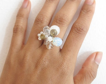 White color crystal flower ring.