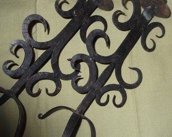 Vintage, antique, primitive hand forged metal candle holders, made of metal with sashi swirls and high step feet