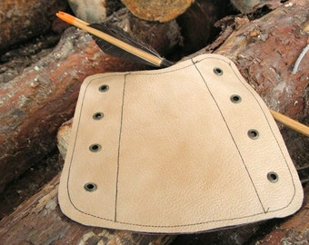 Beige leather archer's barcer