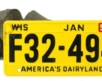 VintageYellow and Black Bicycle License Plate For Wisconsin 1954
