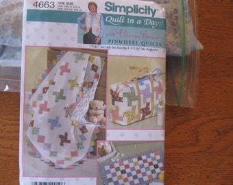 Quilt in a Day Quilt Kit for a Pinwheel Quilt, a large Diaper bag, and a Baby Changing pad