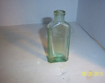 1920s  Three IN One Oil Bottle 3 3/4, inches tall  citron yellow green  medicine bottle