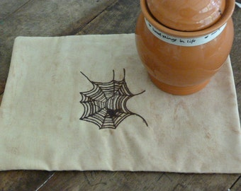 Embroidered candle mat