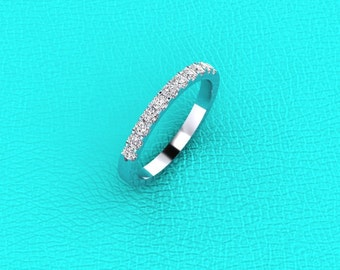 Platinum shared prong Diamond band.