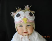 Baby Crochet Owl Hat in pink and tan with big eyes and ear flaps for warmth.  Ties under chin.