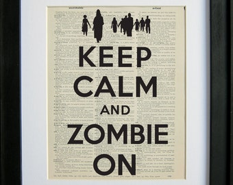 Keep Calm and Zombie On printed on a page from an antique dictionary by Le Papier Gallery