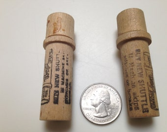pair wooden needle holders with steel needles inside