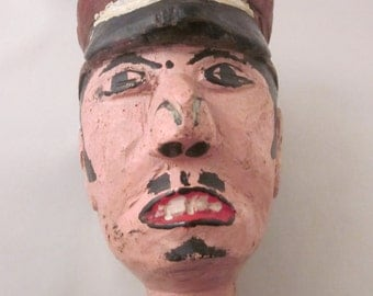 Head of puppet police man