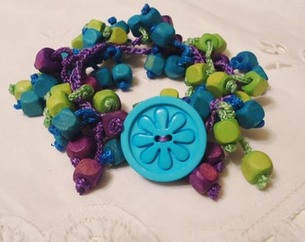 Jewel Tone Hand Crocheted Bracelet Hippy, Shaggy with Flower Button Closure