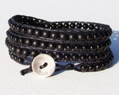 Wrap bracelet with matt and glossy black glass pearl beads