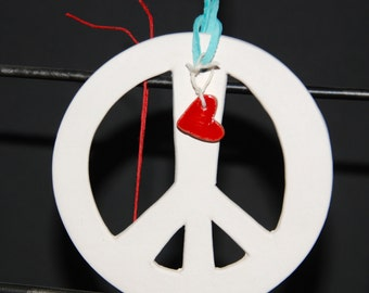 "Ring in the holidays with a hand crafted ""Peace"" ornament."