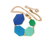 Blue and green leather necklace in colourful geometric diamond shapes