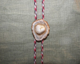 White Rock with Gold Chain on Antler Button Bolo Tie