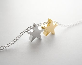 Silver bracelet with two gold and silver stars