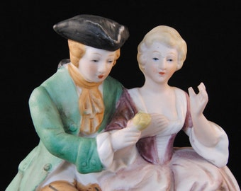 Vintage porcelain figurine of a Victorian couple by KPM