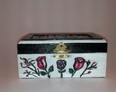 Small wood trinket box, Gold tone clasp, Hand painted white red roses, green leaves, Black accent color, Back-black and red  abstract design