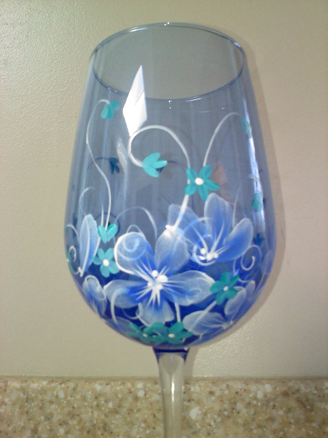 Hand painted wine glass in blue floral Images of painted wine glasses