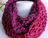 This orchid infinity scarf is hand knitted, open and lacy and perfect for any occasion.  Made with a beautiful blended color mix of yarns
