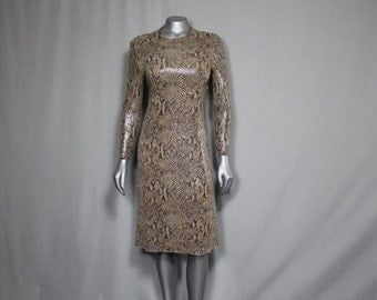 SALE (was 75.00 now 55.00) Slither on into the party in this Faux snake skin dress that will hug you like a constictor
